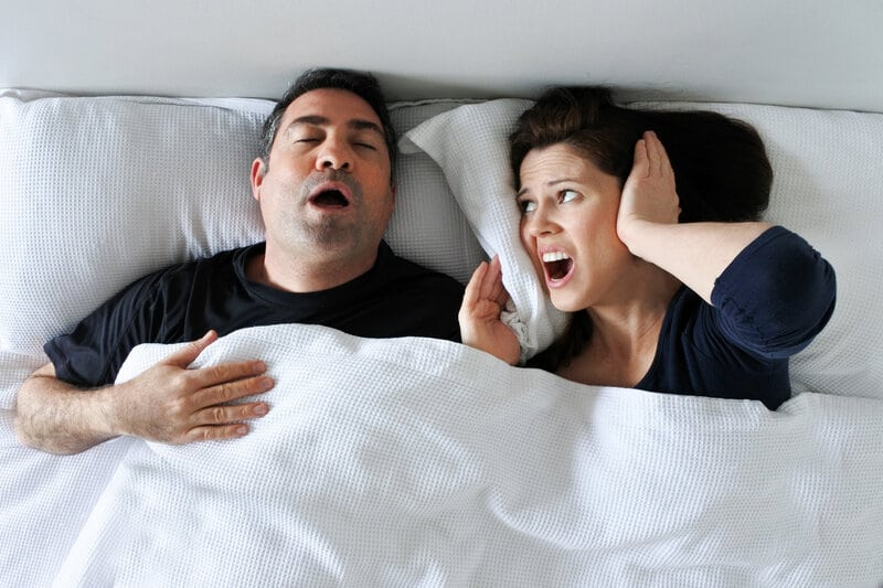 man snoring keeping woman awake - man is a good candidate for oral appliance therapy