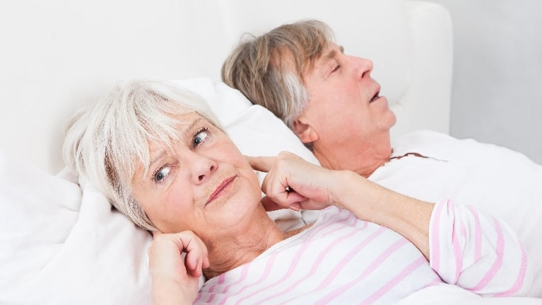 snoring partner keeping spouse awake