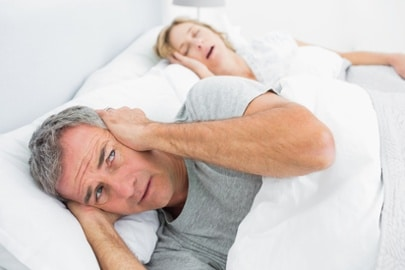 snoring partner keeping spouse awake